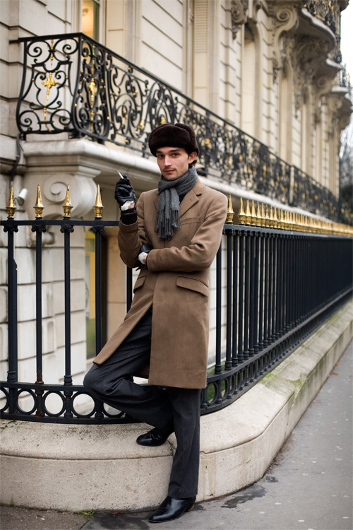 guy smoking brown coat